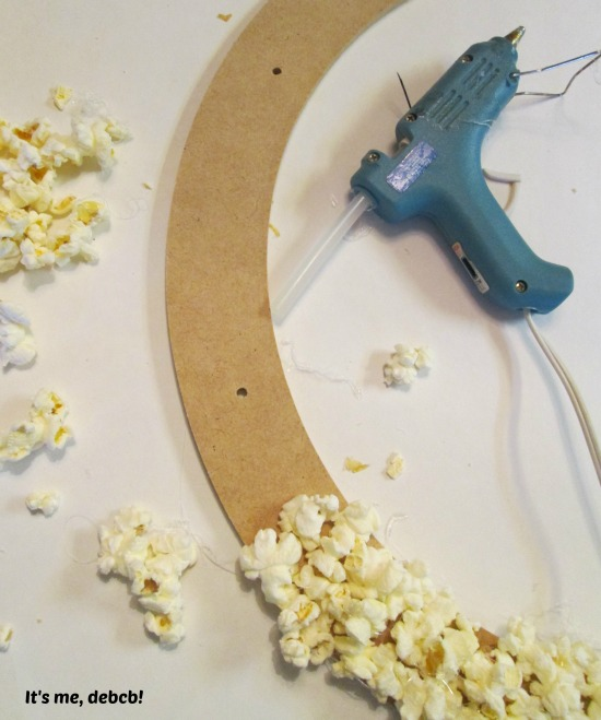 Gluing popcorn on wreath